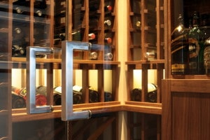Handles on Frameless Glass Doors into Custom Wine Cellar