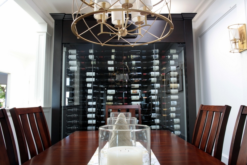 Custom Wine Cabinet With Millwork Surround And Frameless Glass